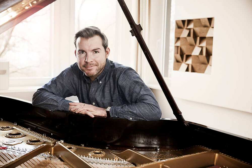 Gwilym Simcock at his piano at home